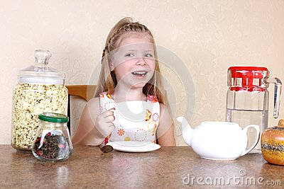 Little girl with cup of hot drink
