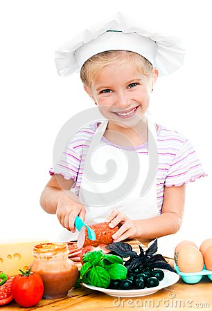 Little girl cuting sausage