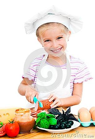 Little girl cuting sausage
