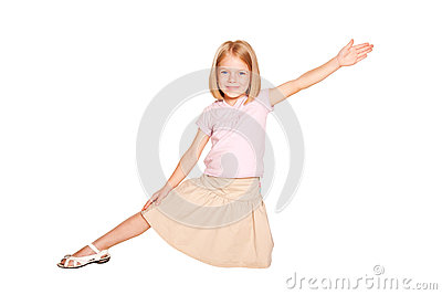 Little girl dancing. Isolated on white