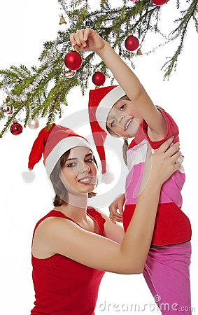 Little girl decorate a christmas tree