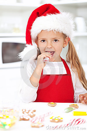 Little girl decorating christmas cookies