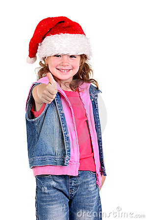 Little girl in denim suit and a hat of Santa Claus