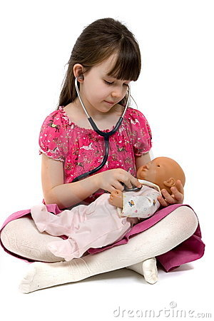 Little Girl Doctor With Stethoscope And Doll