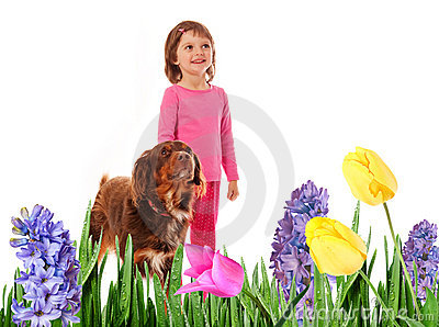 Little girl  with dog in spring garden