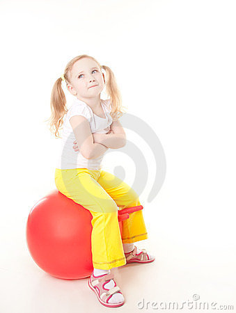 Little girl doing exercise with ball