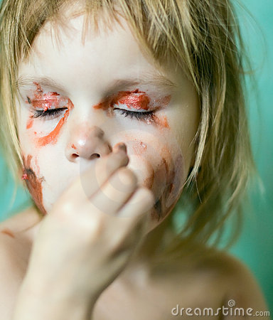 Little girl doing make-up
