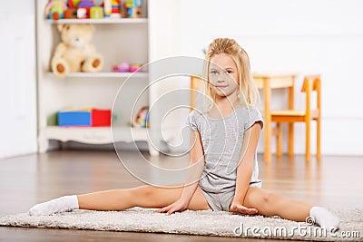 Little Girl Doing Split On The Floor Stock Photo - Image ...