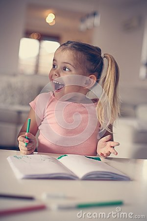 Free Little Girl Drawing And Expressive Positive Emotion. Close Up Image. Stock Photography - 113723322