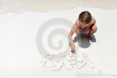 Little girl drawing at beach