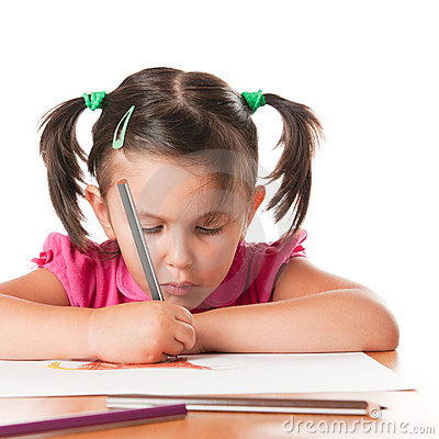 Little girl drawing with concentration