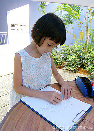 Little girl drawing outdoors