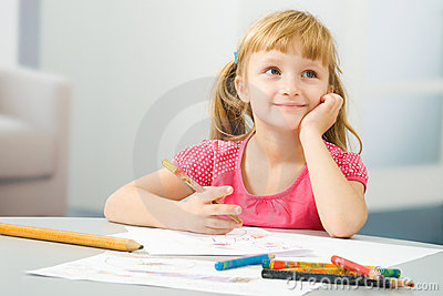 Little girl draws