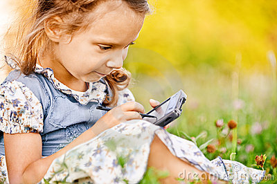 Little girl draws on PDA