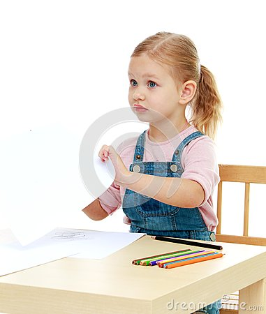 Free Little Girl Draws Pencils Sitting At The Table. Stock Image - 46825681