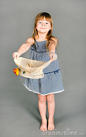 Little girl in a dress with a straw hat