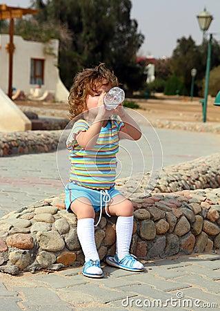 Little girl drinking from bottle