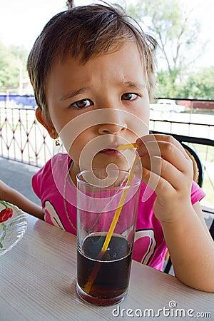 A little girl drinking juice
