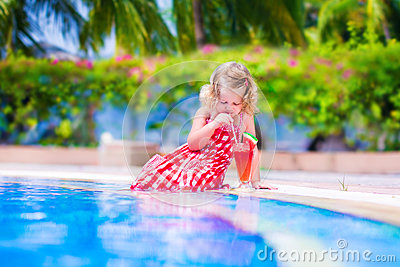 Little girl drinking juice at a swimming pool stock photo image 48869511 How to make swimming pool water drinkable