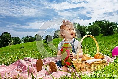 Little girl drinking on picnic
