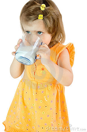The little girl drinks milk