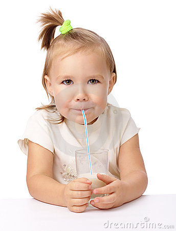 Little girl drinks milk using drinking straw