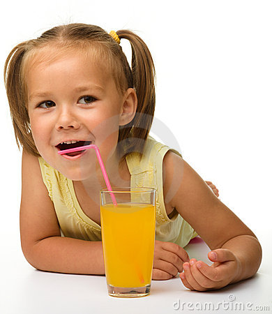 Little girl drinks orange juice