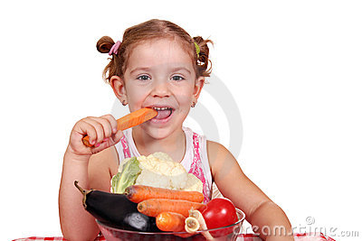 Little girl eat carrot