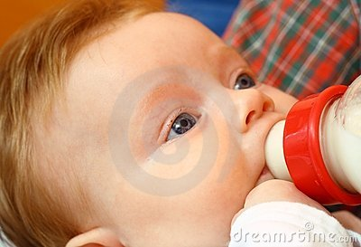 Little girl eat milk