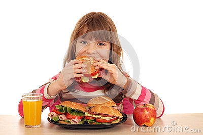 Little girl eat sandwich