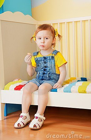 Little Girl Eat Some Snacks Stock Image - Image: 23782681