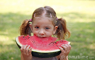 Little girl eat watermelon