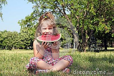 Little girl eat watermelon