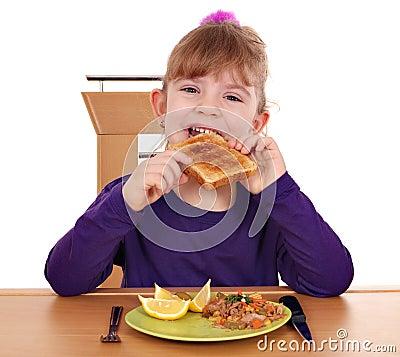 Little girl eating bread