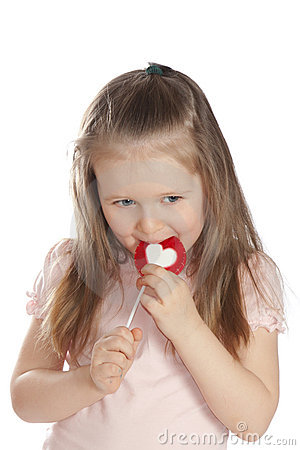 Little girl eating candy  lollipops