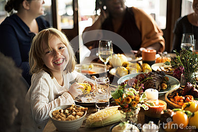 Little Girl Eating Corn Thanksgiving Celebration Concept Stock Photo