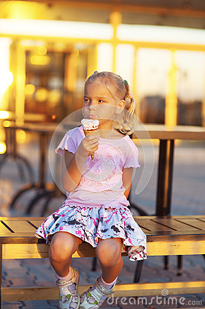 Little girl eating delicious ice