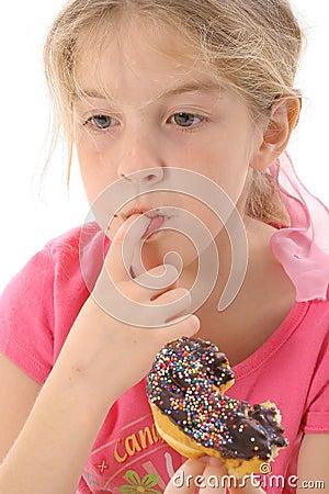Little girl eating a doughnut