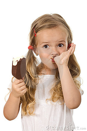 Little girl eating icecream licking fingers