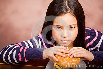 Little girl eating junk food