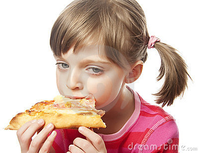 Little girl eating pizza - close up