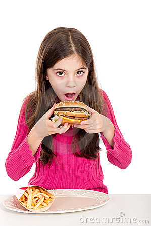 Little girl eating potatoes