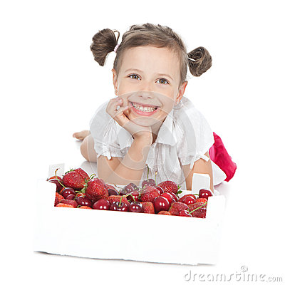 Little girl eating red fruit on white