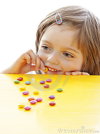 Little girl eating sweets