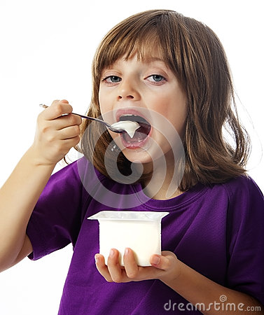 Little girl eating a yogurt