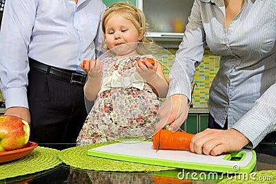 Little girl eats carrot and apples