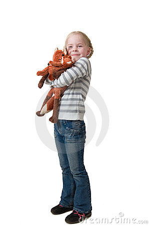 Little girl embraces soft toy