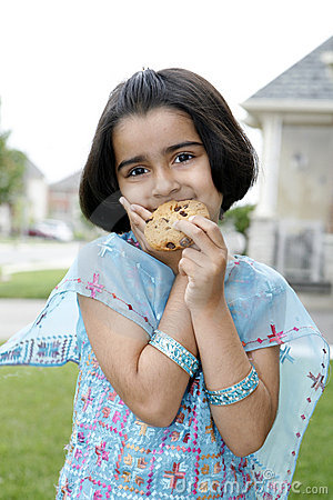 Little girl enjoying cookie