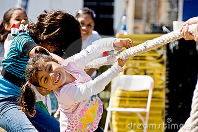 Little girl enjoying Tug of war Editorial Image