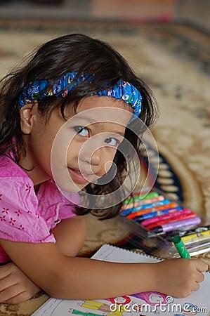 A Little girl Enjoys Coloring